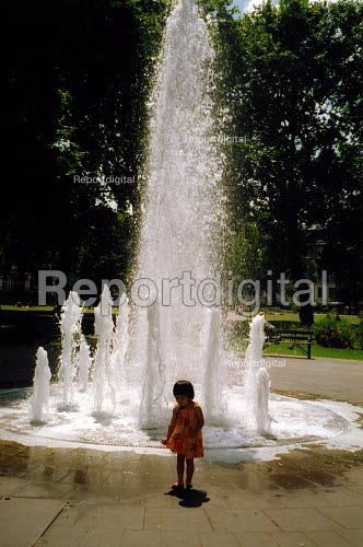 Little girl plays by fountain - Joanne O'Brien - 20021024