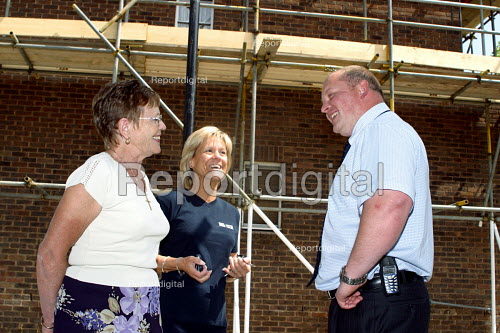 Housing officer talking to tenants about refurbishment of flats, London - Joanne O'Brien - 20021024
