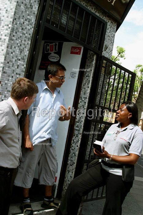 Community wardens talking to shopkeeper, Southwark, London - Joanne O'Brien - 20021024