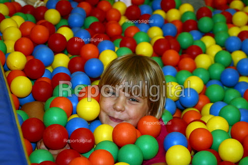 Playing in primary school ball pit. London - Joanne O'Brien - 20021024