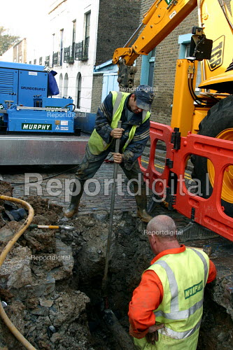Repairing burst water mains in the street London - Joanne O'Brien - 20021024