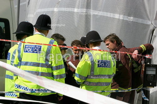 Russell Square, central London. Police & members of the London Fire Brigade working on the recovery of bodies & evidence from the scene of the 7.July 2005 Russell Square Tube bombing - Joanne O'Brien - 2005-07-09
