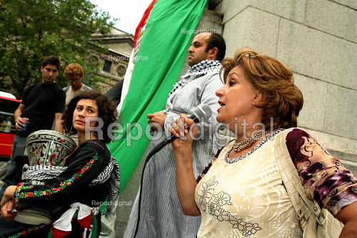 DABKE protest, Trafalgar Square London. Dabke is the name of the national Palestinian folklore dance. Pic shows protester speaking about the current deteriorating humanitarian situation in the Gaza Strip as a result of the on-going Israeli military operation. - Joanne O'Brien - 2006-07-08