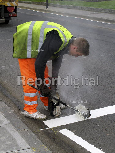 Man painting white lines on road for new pedestrian crossing - Joanne O'Brien - 2008-03-30