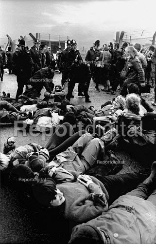 Greenham Common, 1982 Women protest against the deployment of US cruise missiles. Police removing women from a road leading into the base. - Joanne O'Brien - 19821213