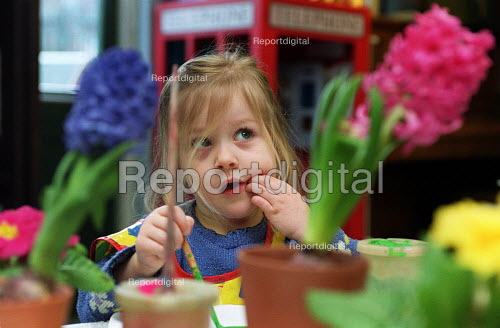 Primary School Child painting in class amid flowers - Roy Peters - 2000-02-12