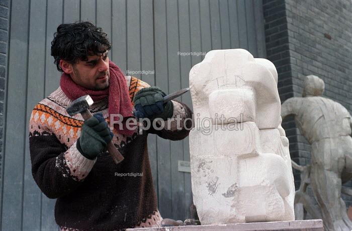 University art student carving a sculpture. - Roy Peters - 1996-11-20