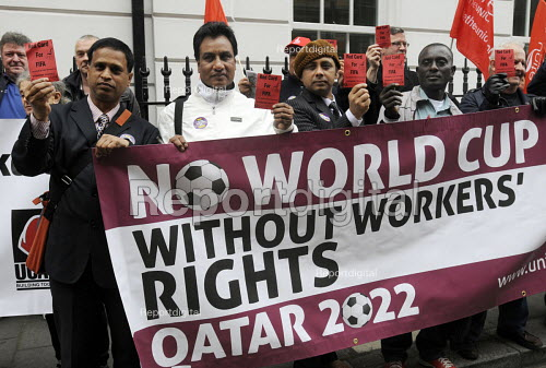 Campaigners hold Red Cards, Qatari embassy in London, Workers Memorial Day protest against loss of lives in the construction industry building the stadiums for the 2022 Football World Cup to be held in Qatar. - Stefano Cagnoni - 2014-04-28