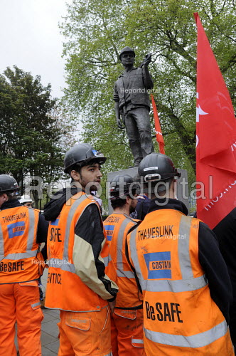 With the statue of the Building Worker towering above them, construction workers and apprentices listening to speakers at International Workers Memorial Day commemoration, Tower Hill in London. - Stefano Cagnoni - 2014-04-28