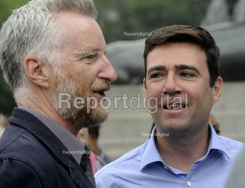 Jarrow People's March for the NHS. After 300 miles the march arrives in London for a demonstration and rally in Trafalgar Square in support of the National Health Service. Singer, Billy Bragg, with Shadown Health Secretary, Andy Burnham MP, at the rally. - Stefano Cagnoni - 2014-09-06