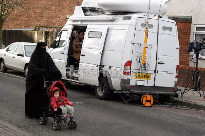 Police anti-terrorist raids in Sparkbrook Birmingham Local residents pass Media outside broadcast van in Sparkhill after raids to foil an alledged terrorist plot. Birmingham. - Stalingrad O'Neill - 2007-02-01