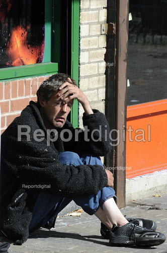 Homeless man outside an off license in Ladywood. Ladywood has the highest levels of poverty and unemployment in the UK - Timm Sonnenschein - 2009-08-28