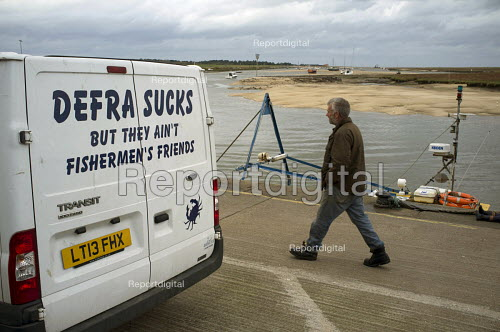 Transit white van with the slogan Defra Sucks But they aint Fishmens Friends parked on the quayside, Wells next the Sea, Norfolk - Janina Struk - 20141018
