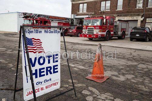 Detroit, Michigan, Vot here, Fire engines are parked outside Fire Station #3 to allow voting inside in primary presidential election - Jim West - 2016-03-08