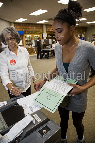 Detroit, Michigan, an election official helping a first-time voter to us an electronic ballot counting machine, voting in the presidential primary election Detroit, Michigan - voting in the primary presidential election - Jim West - 2016-03-08