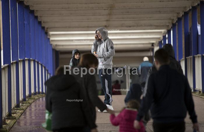 Youth on the phone, shopping precinct, Port Talbot, South Wales - John Harris - 2016-04-04