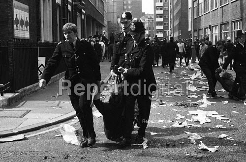 National Front demonstration to Conway Hall in Red Lion Square and counter demonstration led by Liberation, London, 1974. Police Officers arrest anti-fascist protestors. In the riot in the Square following clashes between police and demonstrators, Warwick student, Kevin Gately was killed the first fatality of rioting on British soil in fifty years. - Mike Tomlinson - 1974-06-15