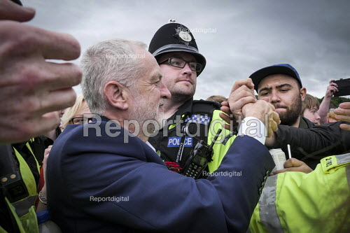 Jeremy Corbyn is mobbed by supporters after his speech, Durham Miners Gala 2016, Co Durham - Mark Pinder - 2016-07-09