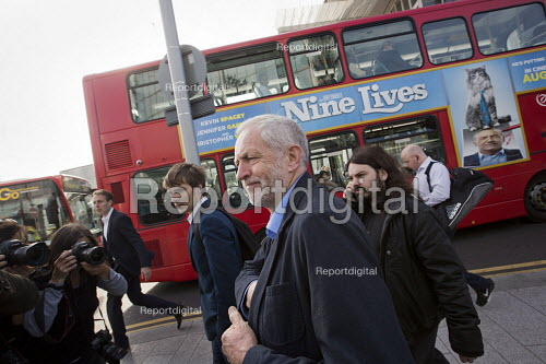 Jeremy Corbyn with a Nine Lives film advertisement after joining an Action For Rail protest against rail fare rises and for public ownership, London Bridge Station, London. - Jess Hurd - 2016-08-16