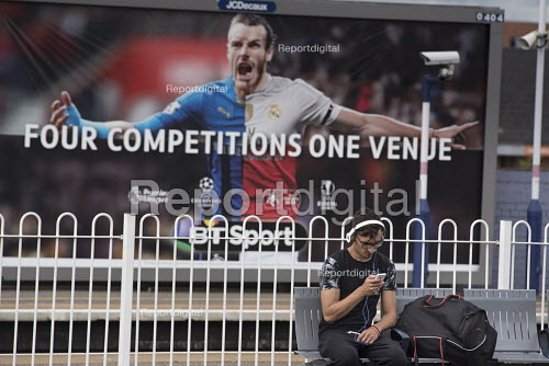 Young man with smartphone and headphones, BT Sports advertisement, Cricklewood, London. - Philip Wolmuth - 2016-08-03