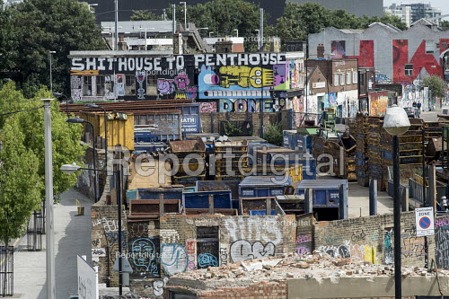 Gentrification in east London. Graffiti and street art on an empty building awaiting demolition, Hackney Wick. Shithouse to Penthouse - Philip Wolmuth - 2016-08-05