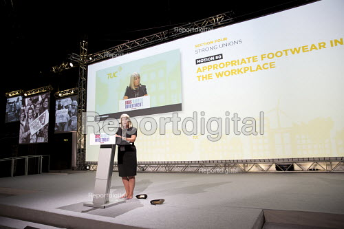 Penny Robinson GMB in the suitable footwear debate kicks off her high heels at TUC conference Brighton - Jess Hurd - 2016-09-11