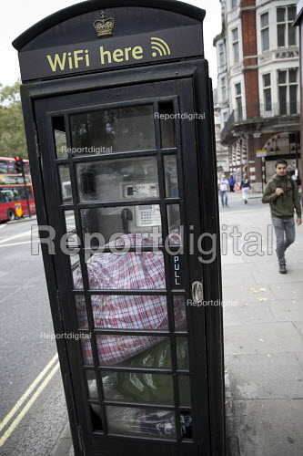 Bags left by a homeless person in a telephone and wifi box, Piccadilly, Central London. - Jess Hurd - 2016-09-17