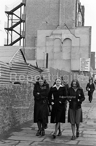 Young women walking confidently along the street, Tower Hamlets, one of the poorest boroughs in the UK, 1976. - Angela Phillips - 1976-02-12