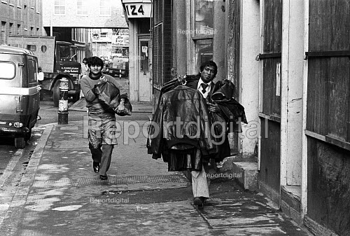 Market traders in the clothing trade, Tower Hamlets, one of the poorest boroughs in the UK, 1976 - Angela Phillips - 1976-02-12