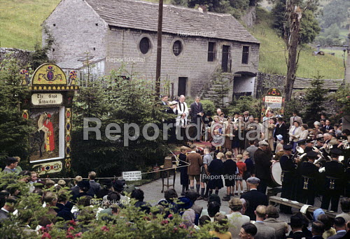 Well Dressing ceremony in 1949 in the small village of Stoney Middleton in the Peak District of Derbyshire. Well Dressing is a Christian tradition developed originally from pagan custom of making sacrifice to the gods of wells and springs to ensure a continued supply of fresh water. - Elisabeth Chat - 1949-08-06
