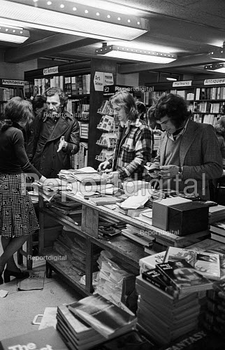 Staff and customers, Foyles Bookshop, Charing Cross Road, London 1975 - John Sturrock - 1975-11-25