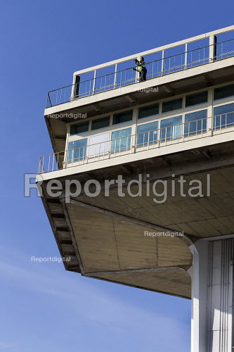 Maintenance worker brushing off rust and loose paint, The Pennine Tower, Lancaster (Forton) Services M6 Motorway Lancashire - John Harris - 2016-09-20