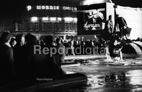 Labour Party victory in 1966 General Election. Crowds celebrating Labour General Election win in Trafalgar Square broadcast live on BBC TV with host Cliff Michelmore - Patrick Eagar - 1966-03-31