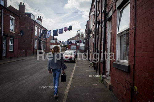 A young man walking home with his practice amp. Leeds - Connor Matheson - 2016-05-05