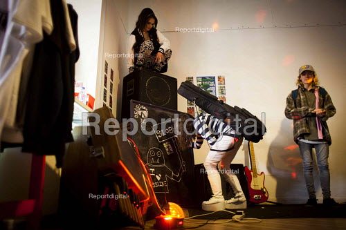 Customers preparing for a photo shoot, Golden Harvest headshop. Sheffield city center, South Yorkshire - Connor Matheson - 2016-04-07