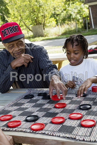 Detroit, Michigan, Elderly man and a young boy playing draughts at a block party - Jim West - 2016-09-24
