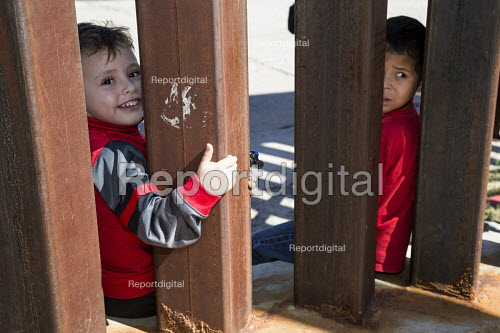 Nogales, Sonora Mexico, Boys on the USA side of the USA Mexican border fence, looking into Mexico - Jim West - 2016-10-08
