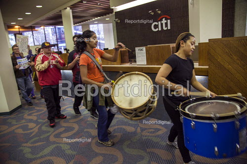 Oakland, California. Protest inside a branch of CItibank who have financed the Dakota Access Pipe Line by activists opposing construction and in solidarity with the Standing Rock Sioux water protectors - David Bacon - 2016-11-10