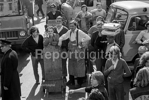 1971 Covent Garden porters look on bemused at Buttons, President of Hell's Angels England chapter arriving for a press conference to launch a book about his life The Making of a President - Martin Mayer - 1971-10-06