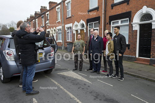 Christopher Furlong of Getty Images taking a photograph with a camera phone of Gareth Snell and Jeremy Corbyn MP, Labour Party canvassing, Cauldon, Stoke on Trent Central, Staffordshire - John Harris - 2017-02-18