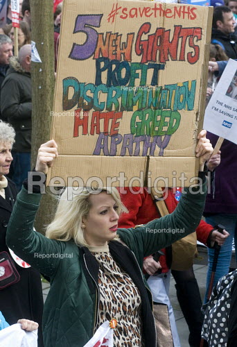 It's Our NHS, National Demonstration to defend the NHS, London. The new Five Giants: Profit, Discrimination, Hate, Greed, Aparthy refering to the Beverage Report - Stefano Cagnoni - 2017-03-04