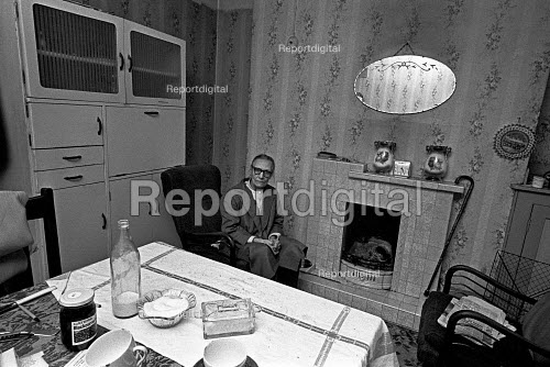 Woman caring for her bedridden sister sitting in her front room alone. London 1972 - NLA - 1972-11-25