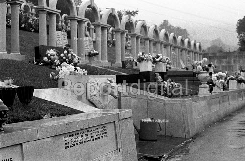 Aberfan disaster, South Wales. White arches in Bryntaf Cemetery, Aberfan mark the graves of the 116 children killed in the disaster, when a coal tip collapsed and engulfed a school in 1966 - Peter Arkell - 1971-10-16