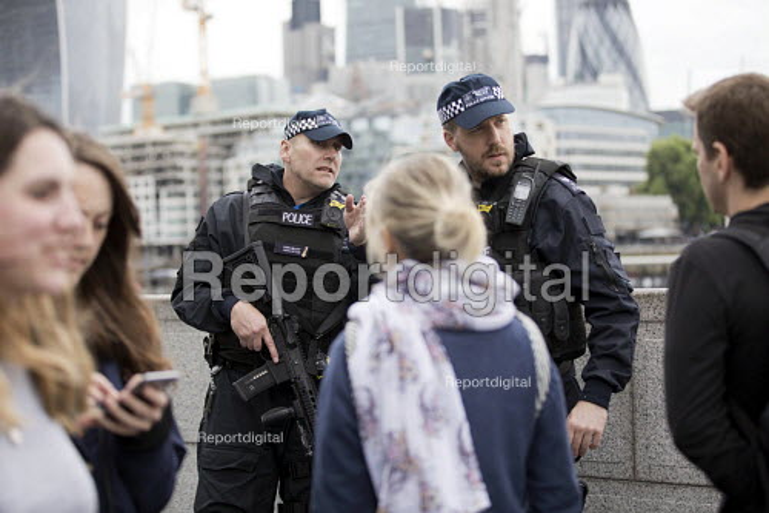 SCO19 Armed Response Officers patrolling a vigil to honour victims of the London Bridge terrorist attack, City Hall, Potters Fields Park, London - Jess Hurd - 2017-06-05