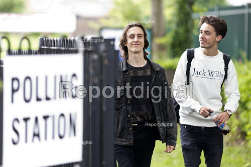 Young first time voters leaving a Polling Station having voted for the Labour Party, General Election, Stratford-upon-Avon, Warwickshire - John Harris - 2017-06-08