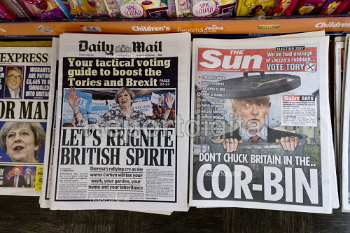Front page headlines in a newsagents shop, Theresa May in The Daily Mail, Jeremy Corbyn in The Sun - John Harris - 2017-06-08