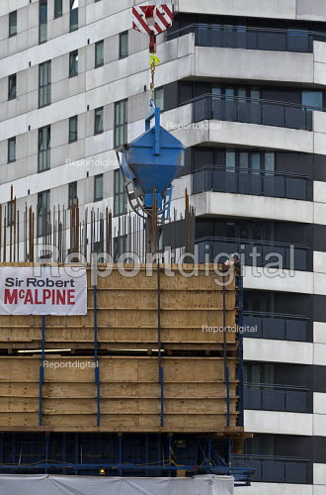 Pouring concrete from a crane, Sir Robert McAlpine construction site, Birmingham city centre. - John Harris - 2017-06-09