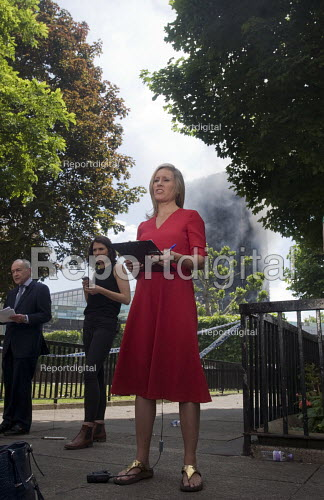 Grenfell Tower Fire. BBC TV News at One report led by Sophie Raworth as smoke still smoulders behind her a full 12 hours after the raging inferno that engulfed the West London tower block resulting in the loss of many lives - Stefano Cagnoni - 2017-06-14