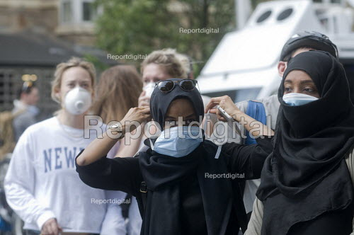 Grenfell Tower Fire. Residents from the local community don face masks to protect them from the smoke and fumes still in the air more than 12 hours after in the fire that engulfed the West London tower block overnight - Stefano Cagnoni - 2017-06-14