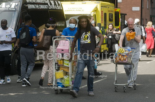 Grenfell Tower Fire. Local residents bring donations to the Latymer Community Church Centre in West London just a few hundred metres from Grenfell Tower to help victims of the disaster many of whom lost everything they own from their homes in the fire that engulfed the tower block overnight - Stefano Cagnoni - 2017-06-14